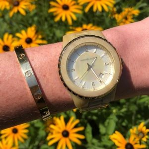 Michael Kors cream horn watch with mother of pearl
